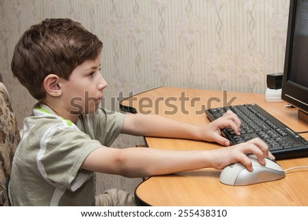 little boy running on the computer - stock photo