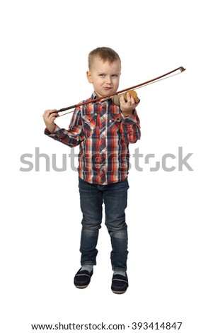 Little boy saws a piece of wood using a bow, imagining violin playing isolated on white background