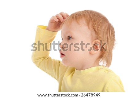 Little boy scratches his head in puzzlement or confusion, as if pondering a deep question. Isolated on white - stock photo