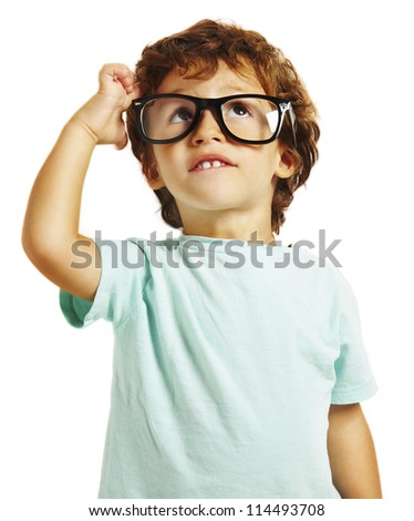 little boy scratching his head thinking isolated on white background - stock photo