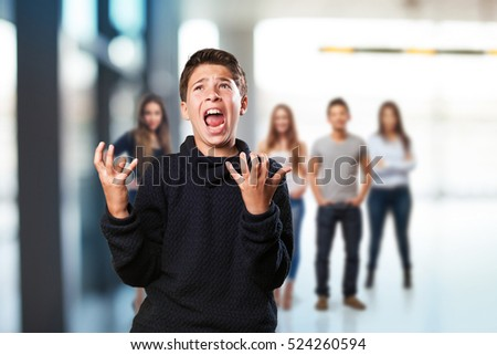 little boy shouting and angry