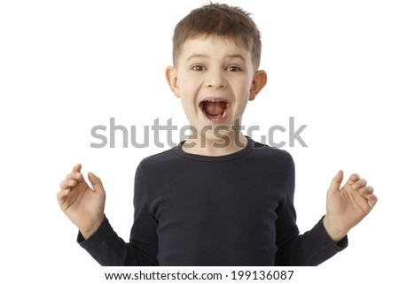 LIttle boy shouting happy, looking surprised with open arms.