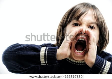 Little boy shouting making hand gesture on mouth - stock photo