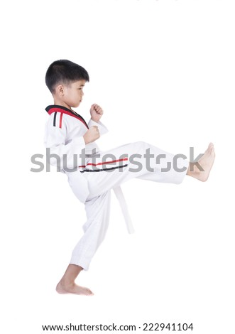 Little Boy Show tricks In taekwondo suit on a white background.