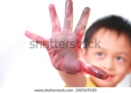 Little boy showing hands painted in colors - stock photo