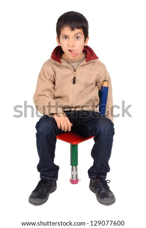 little boy sitting in a chair