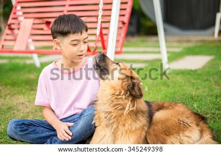 Little boy sitting with dog friendship - stock photo