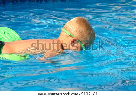 Little Boy Snorkels in Swimming Pool - stock photo
