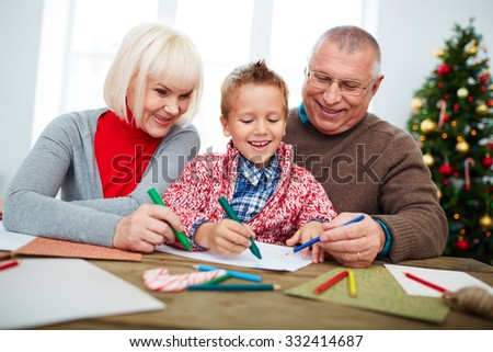Little boy spending time with grandparents at Christmas