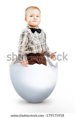LITTLE BOY STANDING IN EASTER EGG ON WHITE BACKGROUND - stock photo