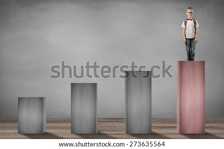little boy standing on the top step - stock photo