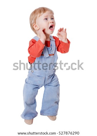 Little boy standing screaming and holding his hands near mouth isolated on white