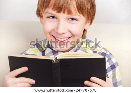 little boy studying the scriptures. - stock photo