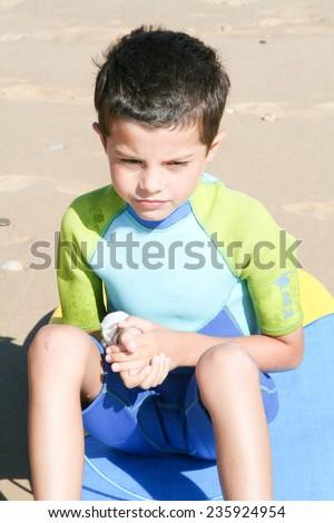 Little boy surfing - stock photo