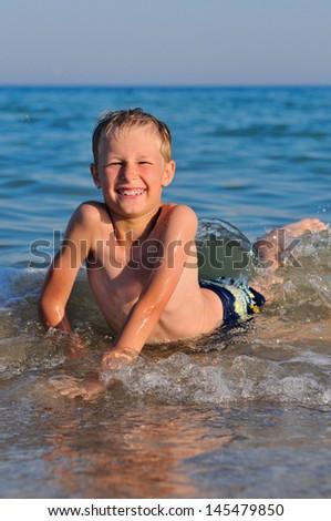 Little boy swimming in sea - stock photo