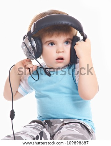 little boy takes off the headphones