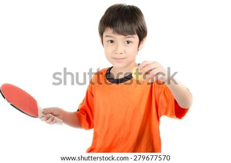 Little boy talking table tennis bat on white background - stock photo