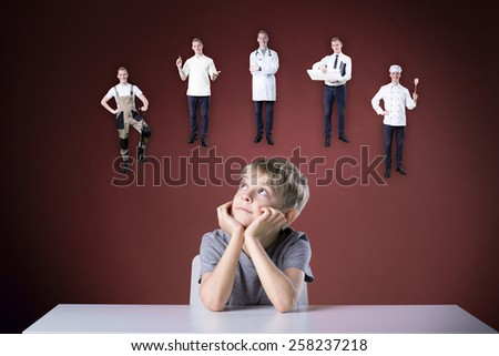 Little boy thinking about his future - stock photo