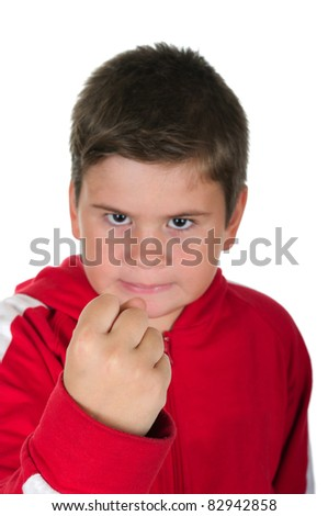 Little boy threatens with a fist on a white background - stock photo