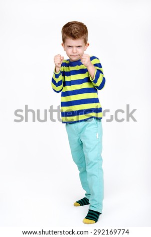 Little boy threatens with a fists on white background - stock photo