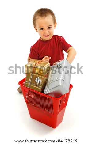 Little boy throwing nice presents in garbage bin. Concept of kids overwhelmed with unusable gadgets - stock photo