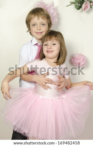 Little boy to a beautiful smiling little girl. Valentine day - stock photo