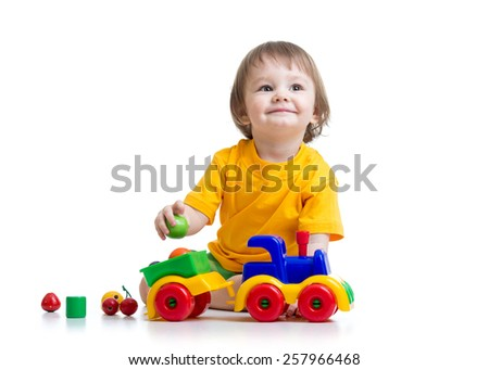 little boy toddler playing with toy isolated - stock photo