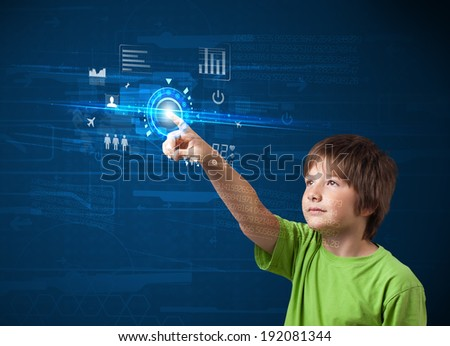 Little boy touching future web technology buttons and icons  - stock photo