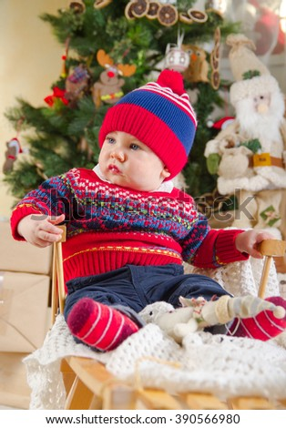 little boy under the Christmas tree - stock photo