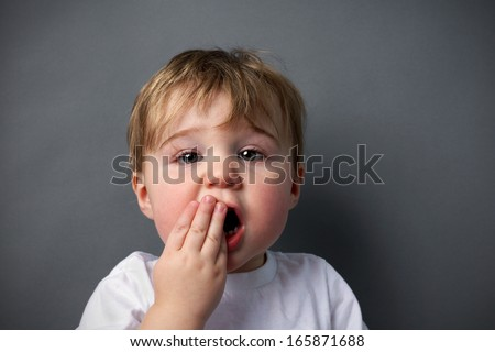 Little boy upset or hurting, toothache or other booboo concept. - stock photo