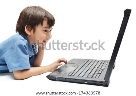 Little  boy use laptop for education on white background - stock photo