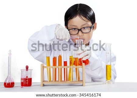 Little boy using chemical fluid and test tube to make chemical research, isolated on white background