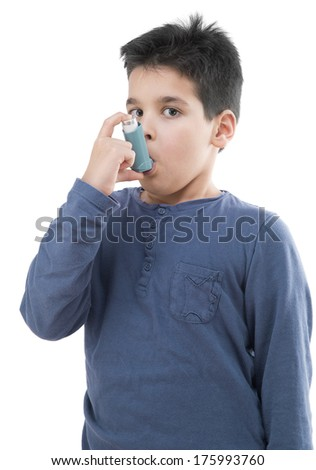little boy using inhaler for asthma - stock photo