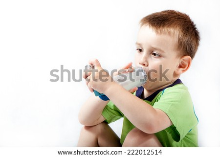 Little boy using inhaler for asthma isolated on white background - stock photo