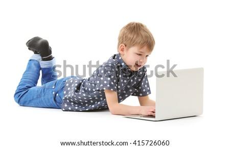 Little boy using laptop isolated on white - stock photo
