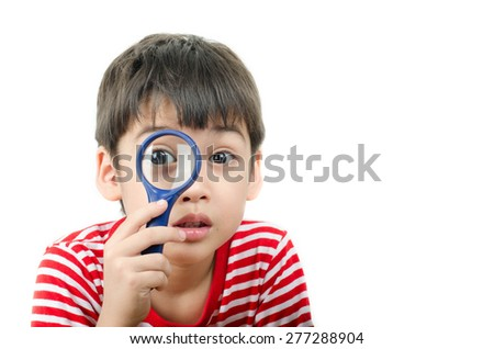 Little boy using magnifier looking close up on white background - stock photo