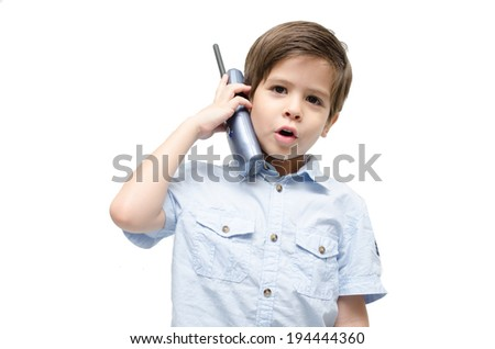 Little boy using phone call on white background