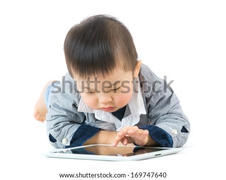 Little boy using tablet - stock photo