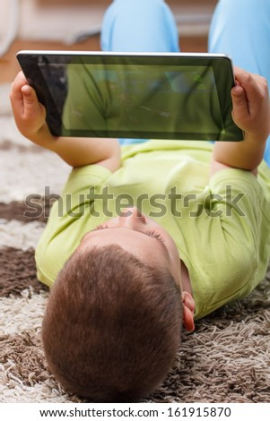 Little boy using tablet computer  - stock photo