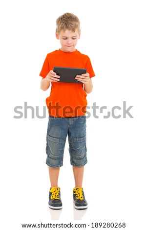 little boy using tablet computer isolated on white
