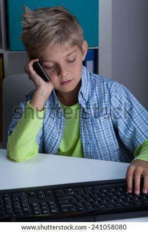 Little boy using technology in life, vertical - stock photo