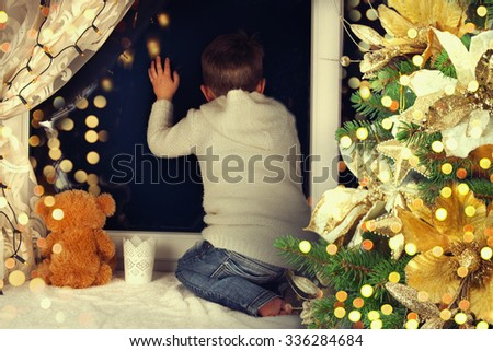 Little boy waiting for Santa Clause.