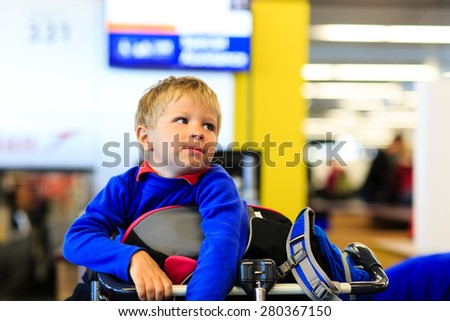 little boy waiting in the airport, child travel