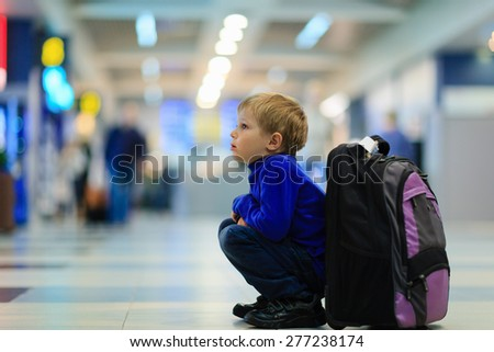 little boy waiting in the airport, kids travel - stock photo