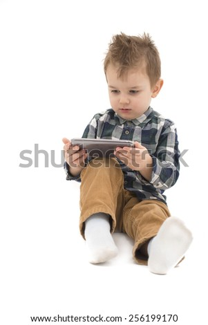 Little boy watching cartoons at cell phone