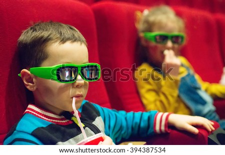Little boy watching movie in 3d glasses. - stock photo