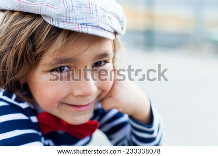 little boy wearing a beret and a bow tie - stock photo