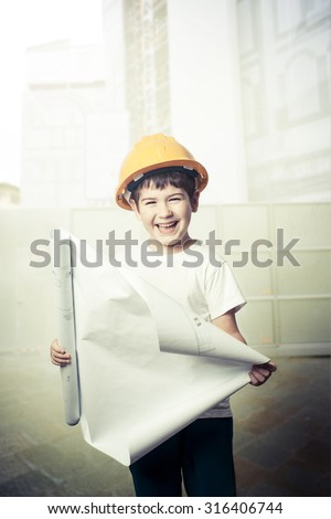 little boy wearing a engineering helmet - stock photo