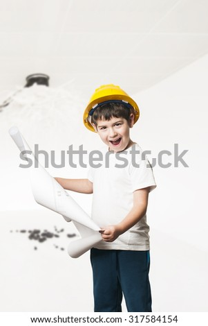 little boy wearing a engineering helmet