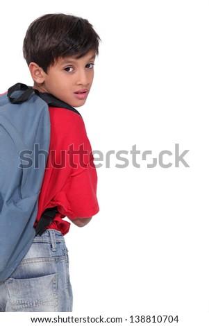 Little boy wearing a rucksack - stock photo